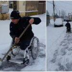 Un bărbat în scaun cu rotile, filmat când deszăpezește strada | VIDEO